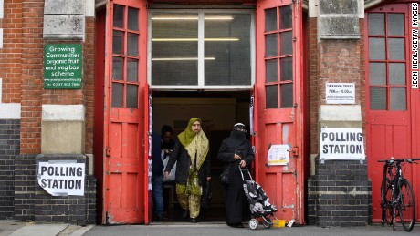 LONDON, UNITED KINGDOM - JUNE 08:  Members of the public cast their votes at a former fire station on June 8, 2017 in London, United Kingdom. Polling stations have opened as the nation votes to decide the next UK government in a general election.  (Photo by Leon Neal/Getty Images)