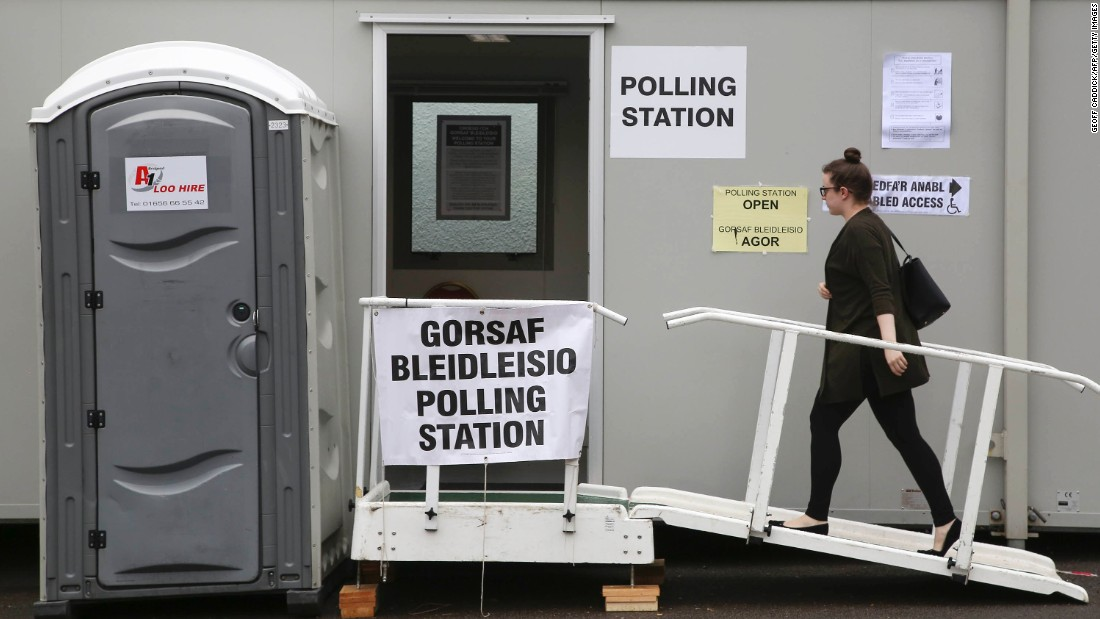 A woman walks into a polling station in Cardiff.