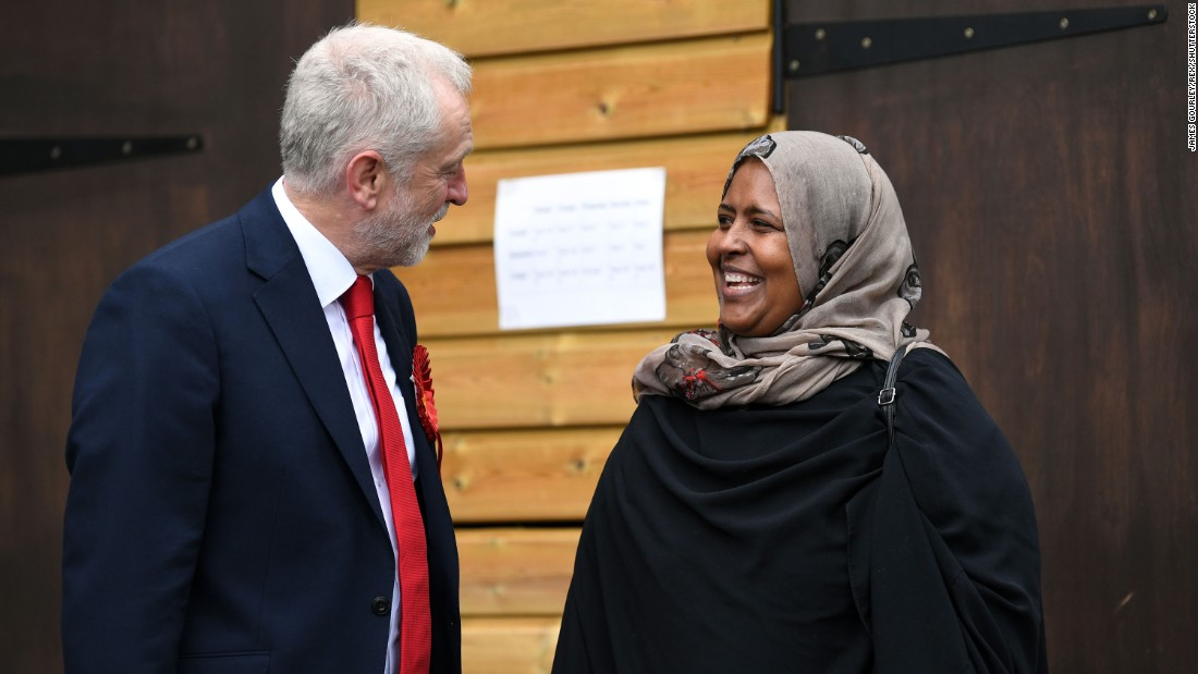 Labour Party leader Jeremy Corbyn speaks to a member of the public before casting his vote at a school in London.