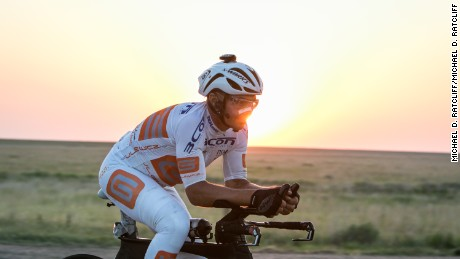 With a smile on his face, RAAM Solo rider Gerhard Gulewicz  rides into the night in the plains of Kansas.