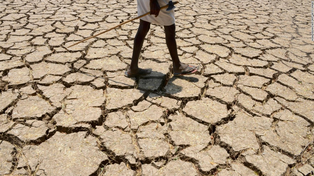 "An Indian farmer in a dried up cotton field in the southern Indian state of Telangana, in April 2016. Much of India is <a href=""http://edition.cnn.com/2016/05/04/asia/gallery/india-drought-crisis/index.html"">reeling</a> from a heat wave and severe drought conditions that have decimated crops, killed livestock and left at least 330 million people without enough water for their daily needs."