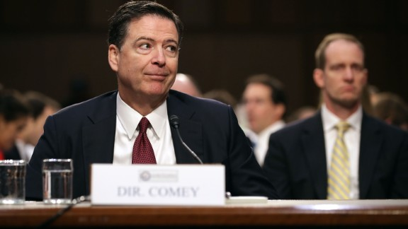 Former FBI Director James Comey immitates a gesture he said he saw President Donald Trump make during one of their conversations while he testifies before the Senate Intelligence Committee in the Hart Senate Office Building on Capitol Hill June 8, 2017 in Washington, DC. Comey said that President Donald Trump pressured him to drop the FBI's investigation into former National Security Advisor Michael Flynn and demanded Comey's loyalty during the one-on-one meetings he had with president.