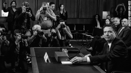 Former FBI director James Comey arrives to testify before the Senate Intelligence Committee in Washington, DC on June 8, 2017.