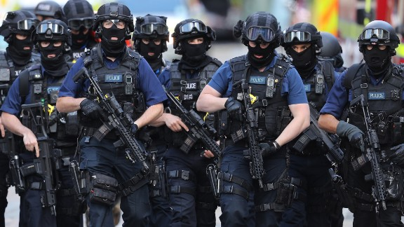 Counterterrorism officials patrol near the scene of a terror attack on London Bridge on Sunday, June 4. Eight people were killed and at least 48 were wounded Saturday night when three attackers rammed a vehicle into pedestrians on London Bridge and then went on a stabbing spree at bars and restaurants at nearby Borough Market.