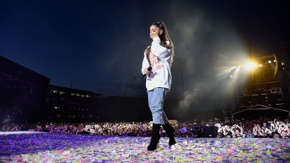 Ariana Grande wipes a tear as she performs during the One Love Manchester Benefit Concert in Manchester, England, on Sunday, June 4. The concert aimed to raise money for those affected by the bombing that killed 22 people and wounded more than 100 at Grande's May 22 show.