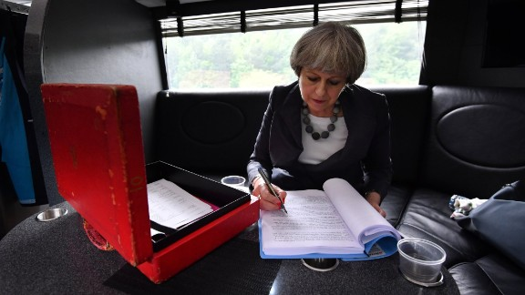 """British Prime Minister Theresa May works on the election campaign bus, commonly known as the """"Battle Bus,"""" as it travels through Staffordshire, England, on Tuesday, June 6. After one of the most tumultuous years in British political history, polls opened in the country's general election on Thursday, June 8. The snap election was called by May with a focus on securing a mandate to take into Brexit talks."""
