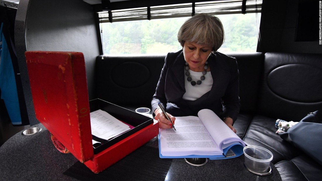 "British Prime Minister Theresa May works on the election campaign bus, commonly known as the ""Battle Bus,"" as it travels through Staffordshire, England, on Tuesday, June 6. After one of the most tumultuous years in British political history, <a href=""http://www.cnn.com/2017/06/08/europe/uk-election-day/index.html"" target=""_blank"">polls opened in the country's general election</a> on Thursday, June 8. The snap election was called by May with a focus on securing a mandate to take into Brexit talks."