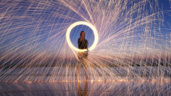 A Palestinian man spins a lit firework during Ramadan in Deir Al-Balah, a Palestinian city in central Gaza,  on Sunday, June 4. Ramadan is the Islamic holy month of fasting during which Muslims may not eat or drink during daylight hours.