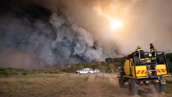 Firefighters battle a blaze n