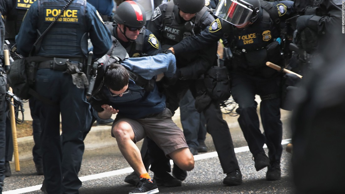 "A demonstrator is arrested during <a href=""http://www.cnn.com/2017/06/04/us/portland-protests/index.html"" target=""_blank"">protests in Portland, Oregon,</a> on Sunday, June 4. Hundreds of supporters of US President Donald Trump converged on Terry D. Schrunk Plaza for an event billed as a ""Trump Free Speech"" rally, but they were slightly outnumbered by a mixed assemblage of counterprotesters across the street. At least 14 people were arrested."