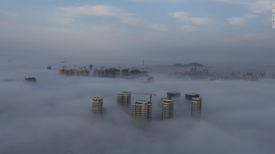 Buildings and construction sites are seen among fog in Rizhao, China, on Friday, June 2.