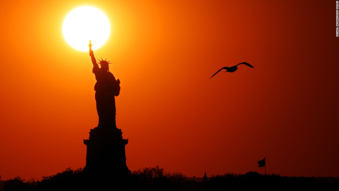 "The sun sets behind the Statue of Liberty in New York on Friday, June 2. <a href=""http://www.cnn.com/2017/05/25/world/gallery/week-in-photos-0526/index.html"" target=""_blank"">See last week in photos</a>"
