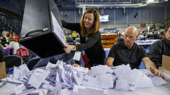 Officials count votes in Glasgow on June 8.