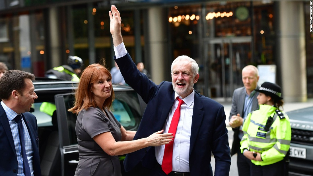 Labour Party leader Jeremy Corbyn greets a crowd as he arrives at Labour Party headquarters in London on June 9. Corbyn, who has called on May to resign, started his election campaign with a deficit in the polls of around 20 points. He ended it with more than 30 extra seats.
