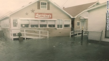 "In 2012 during Superstorm Sandy, Mayor James ""Ooker"" Eskridge snapped this picture of the storm surge pushing up against the local Tangier's restaurant, Lorraine's."