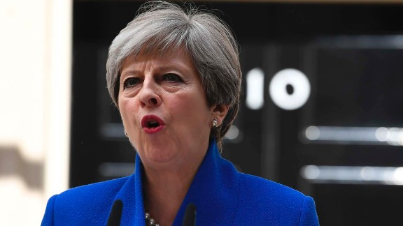 Britain's Prime Minister and leader of the Conservative Party Theresa May delivers a statement outside 10 Downing Street in central London on June 9, 2017 as results from a snap general election show the Conservatives have lost their majority.British Prime Minister Theresa May faced pressure to resign on June 9 after losing her parliamentary majority, plunging the country into uncertainty as Brexit talks loom. / AFP PHOTO / Justin TALLIS        (Photo credit should read JUSTIN TALLIS/AFP/Getty Images)