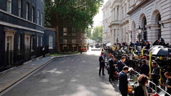 Members of the press wait for May outside 10 Downing Street. May's Conservative Party won 318 seats -- short of the 326 needed for a majority and weakening May's position in upcoming Brexit talks.