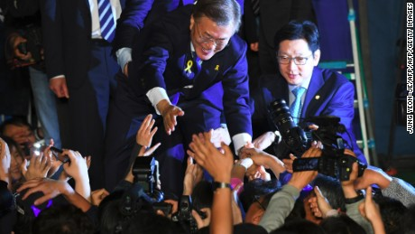 South Korean presidential candidate Moon Jae-in (C) of the Democratic Party greets his supporters.