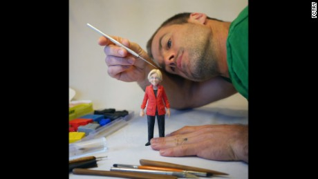 Sculptor Mark Leavitt works on the Warren action figure.