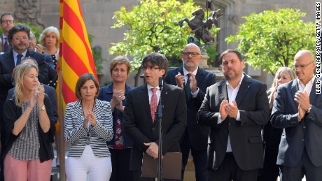 President of the Catalan regional government Carles Puigdemont (C) speaks flanked by president of the Catalan parliament Carme Forcadell (2L) and Catalan regional vice-President and chief of Economy and Finance, Oriol Junqueras (2R), to announce that the referendum on independence will be held on October 1, 2017 at the Palau de La Generalitat in Barcelona on June 9, 2017. The leader of Spain's Catalonia region, where a separatist movement is in full swing, today announced an independence referendum for October 1, in what will exacerbate tensions with Madrid.  / AFP PHOTO / LLUIS GENE        (Photo credit should read LLUIS GENE/AFP/Getty Images)