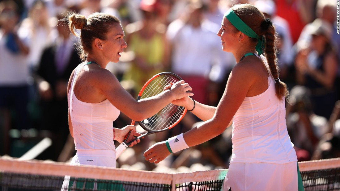 Jelena Ostapenko (right) of Latvia shakes hands with Simona Halep of Romania after victory.