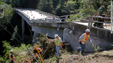 Inspectors check on the demolition of the Pfeiffer Canyon Bridge. It's since been cleared.