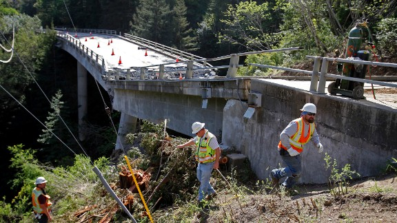 Inspectors check on the the demolition of the Pfeiffer Canyon Bridge. It's since been cleared.