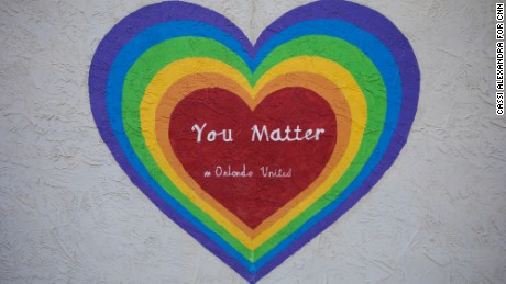 A mural on Mills Avenue. Many in the city's LGBT community say such messages make them stand a little taller.