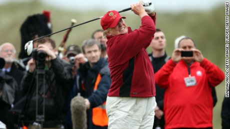 ABERDEEN, SCOTLAND - JULY 10:  Donald Trump opens The Trump International Golf Links Course in Balmedie by hitting the first ball down the first fairway on July 10, 2012 in Balmedie, Scotland. The controversial ?100m course opens to the public on Sunday July 15. Further plans to build hotels and homes on the site have been put on hold until a decision has been made on the building of an offshore windfarm nearby. (Photo by Ian MacNicol/Getty Images)