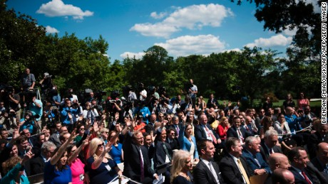 Reporters raise their hands to ask questions of US President Donald Trump and Romania's President Klaus Iohannis during a press conference in the Rose Garden of the White House June 9, 2017 in Washington, DC. / AFP PHOTO / Brendan Smialowski        (Photo credit should read BRENDAN SMIALOWSKI/AFP/Getty Images)