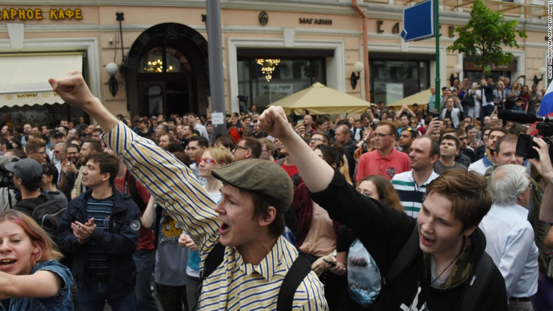 People chant slogans during the rally in Moscow.