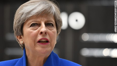 Britain's Prime Minister and leader of the Conservative Party Theresa May makes a statement outside 10 Downing Street in central London on June 9, 2017 as results from a snap general election show her party has lost their majority.
