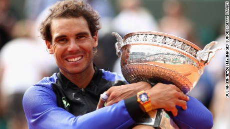 PARIS, FRANCE - JUNE 11:  Rafael Nadal of Spain celebrates victory with the trophy following the mens singles final against Stan Wawrinka of Switzerland on day fifteen of the 2017 French Open at Roland Garros on June 11, 2017 in Paris, France.  (Photo by Julian Finney/Getty Images)