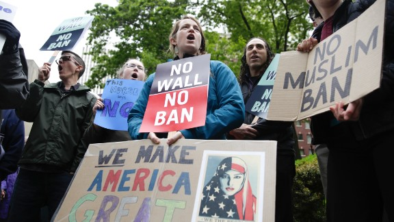 People protest outside as the 9th US Circuit Court of Appeals prepares to hear arguments on US President Donald Trump