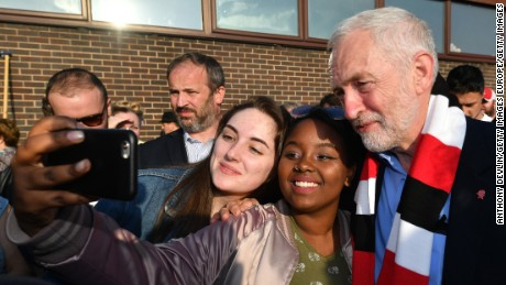 Labour Party leader Jeremy Corbyn takes a selfie photo with young supporters during a campaign event on May 10.
