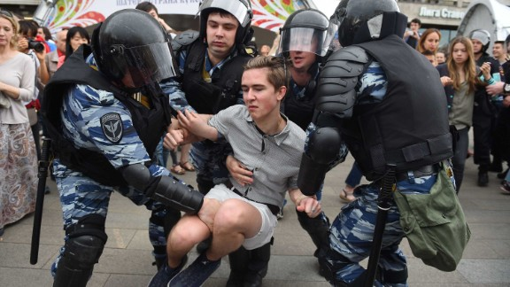 Russian police officers detain a participant of an unauthorized opposition rally in Tverskaya street in central Moscow on June 12, 2017.