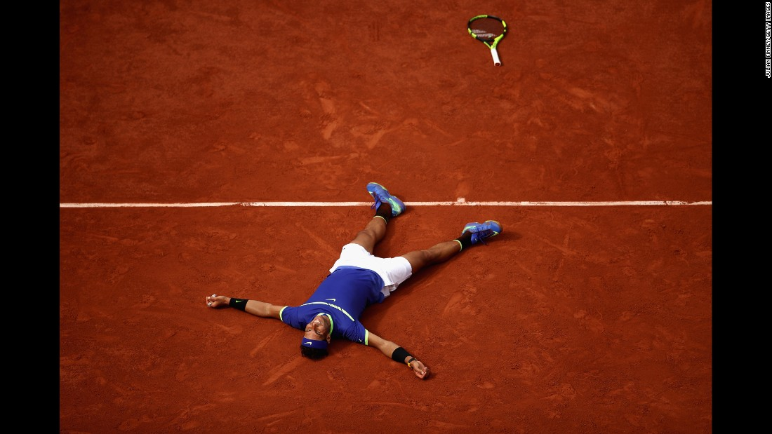 "Rafael Nadal lies on the Roland Garros clay as he celebrates his victory in <a href=""http://www.cnn.com/2017/06/11/tennis/french-open-nadal-wawrinka-decima/index.html"" target=""_blank"">the French Open final</a> on Sunday, June 11. He defeated Stan Wawrinka 6-2, 6-3, 6-1 for his 10th French Open title. It's his 15th Grand Slam in all."
