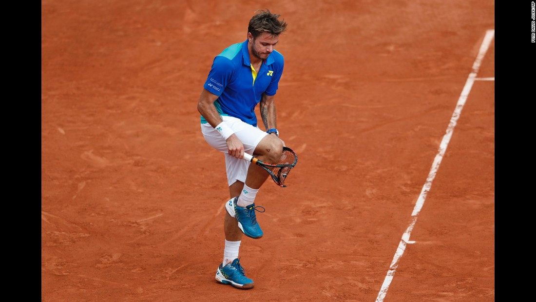 "Stan Wawrinka breaks his racket over his knee during <a href=""http://www.cnn.com/2017/06/11/tennis/french-open-nadal-wawrinka-decima/index.html"" target=""_blank"">the French Open final,</a> which he lost in straight sets to Rafael Nadal on Sunday, June 11."