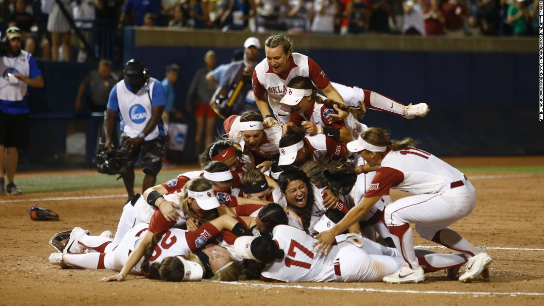 Oklahoma softball players jump in a pile after winning the NCAA title on Tuesday, June 6. They also won the championship last season.