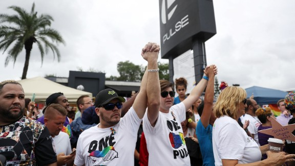 People mark the one-year anniversary of the Pulse nightclub shooting on June 12, 2017 in Orlando, Florida.
