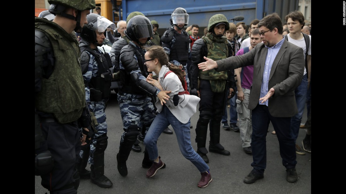 A young girl reacts as her friend is detained by police during a demonstration in downtown Moscow.