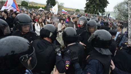 "Russian police officers face demonstrators during an unauthorized opposition rally in centre of Saint Petersburg on June 12, 2017.  Over 200 people were detained on June 12, 2017 by police at opposition protests called by Kremlin critic Alexei Navalny, said a Russian NGO tracking arrests. ""About 121 people were detained in Moscow up to this point. In Saint-Petersburg - 137,"" OVD-Info group, which operates a detention hotline, wrote on Twitter.  / AFP PHOTO / OLGA MALTSEVA        (Photo credit should read OLGA MALTSEVA/AFP/Getty Images)"