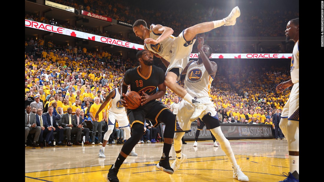 Klay Thompson falls over Tristan Thompson in the low post.