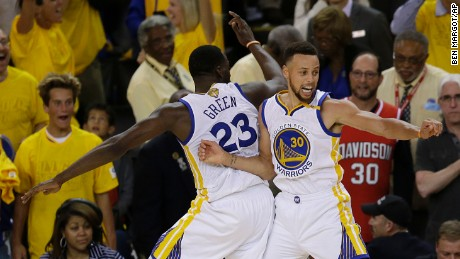 Golden State Warriors forward Draymond Green, left, and guard Stephen Curry (30) celebrate during the second half of Game 5 of basketball's NBA Finals against the Cleveland Cavaliers in Oakland, Calif., Monday, June 12, 2017. The Warriors won 129-120 to win the NBA championship. (AP Photo/Ben Margot)