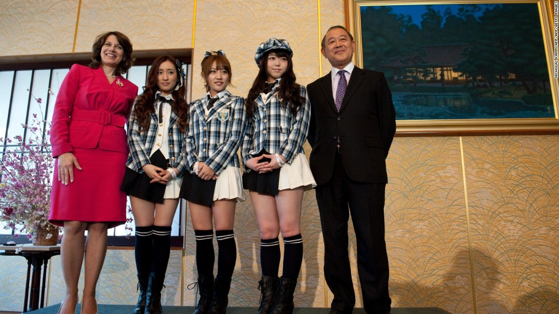 Ayaka Umeda (2L), Minami Takahashi (C) and Minami Minegishi (2R) of Japanese pop group AKB48 pose with Japanese ambassador to the US Ichiro Fujisaki (R) and Diana Mayhew, President of the National Cherry Blossom Festival, after a press conference at the Japanese ambassador's residence in Washington on March 26, 2012. The band was in the US capital as part of the 100th anniversary celebration of the gift of 3,000 cherry trees from the mayor of Tokyo to the city of Washington.