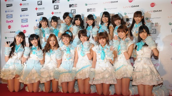 AKB48 poses for photographs on the red carpet during the MTV Video Music Aid Japan at Makuhari Messe on June 25, 2011 in Chiba, Japan.