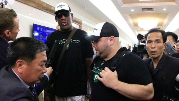 Former NBA basketball star Dennis Rodman is surrounded by North Korean officials and members of the media upon his arrival at Sunan International Airport in Pyongyang, North Korea, on Tuesday, June 13. The trip comes at a time of heightened tension between Washington and Pyongyang.