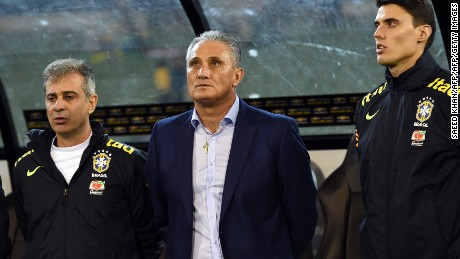 Brazil's head coach Tite (C) listens to their national anthem prior to a friendly international football match between Brazil and Australia in Melbourne on June 13, 2017. / AFP PHOTO / SAEED KHAN / IMAGE RESTRICTED TO EDITORIAL USE - STRICTLY NO COMMERCIAL USE        (Photo credit should read SAEED KHAN/AFP/Getty Images)