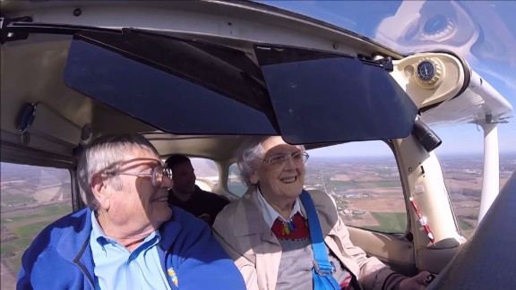 "Mildred ""Milly"" Reeves, right, flies a Cessna Model 172 with assistance from pilot Pete Lockner, left. (Screengrab of family video/YouTube)"