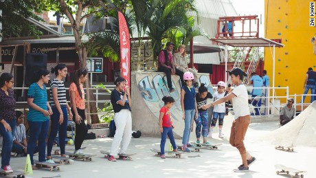 During a workshop, Verghese teaches kids how to skateboard.